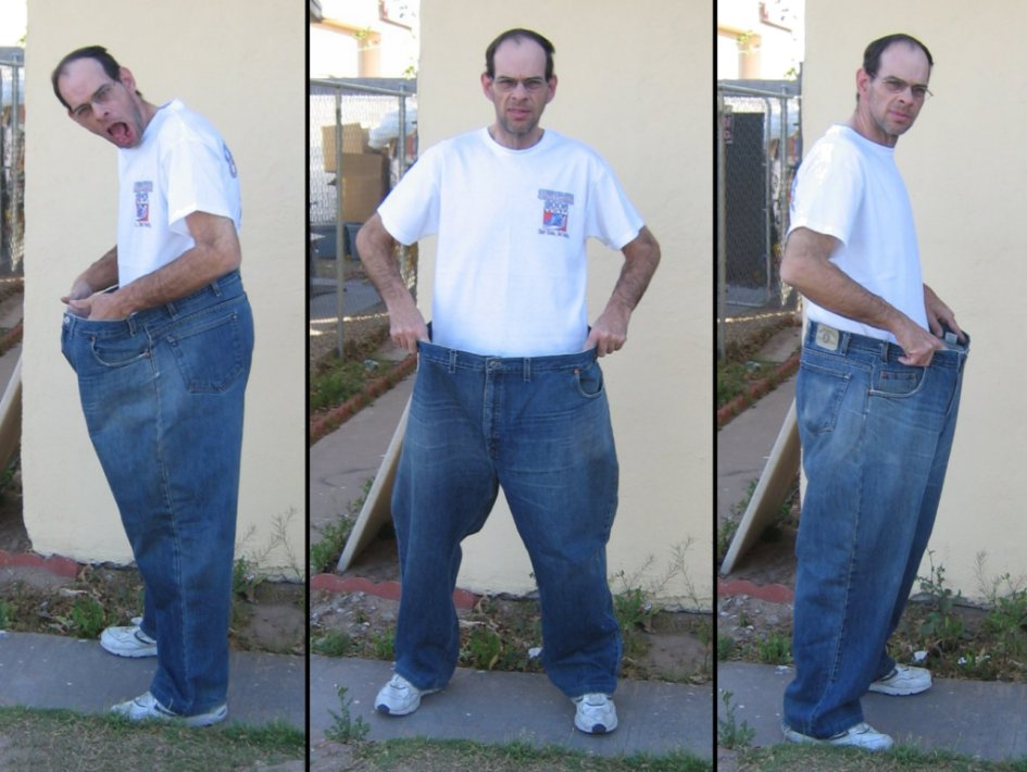 24 months post-surgery - Holding up the size 54 inch pant I wore nearly three years ago.